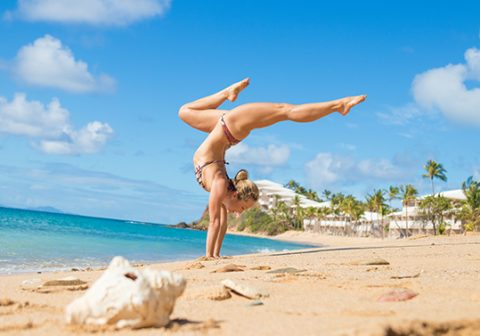 Enjoying yoga on the beach